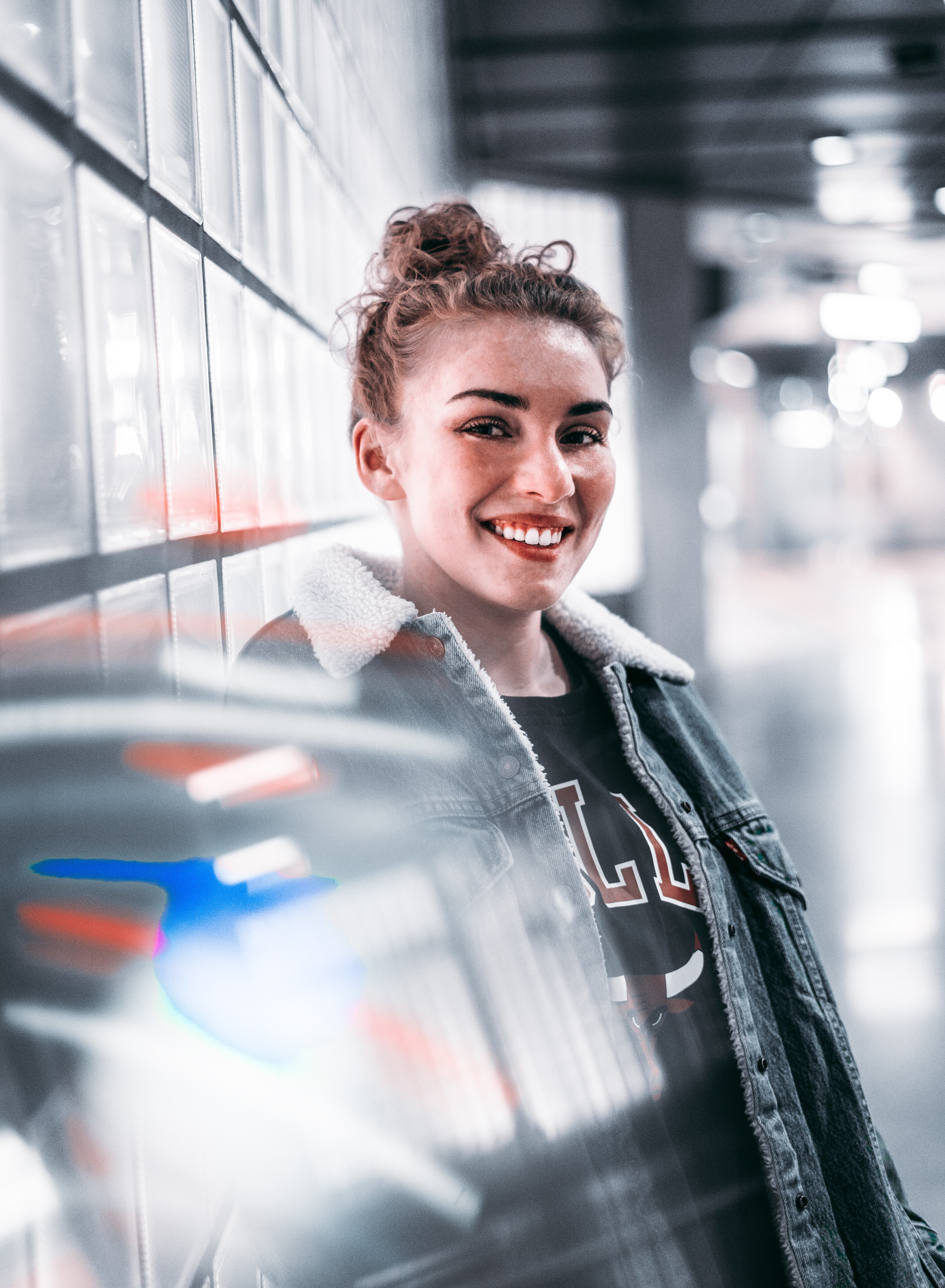 smiling woman wearing blue denim jacket