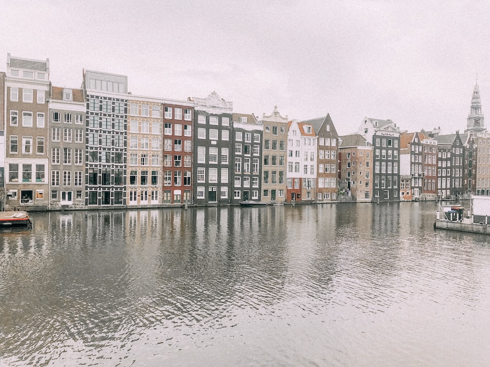 body of water in front of buildings