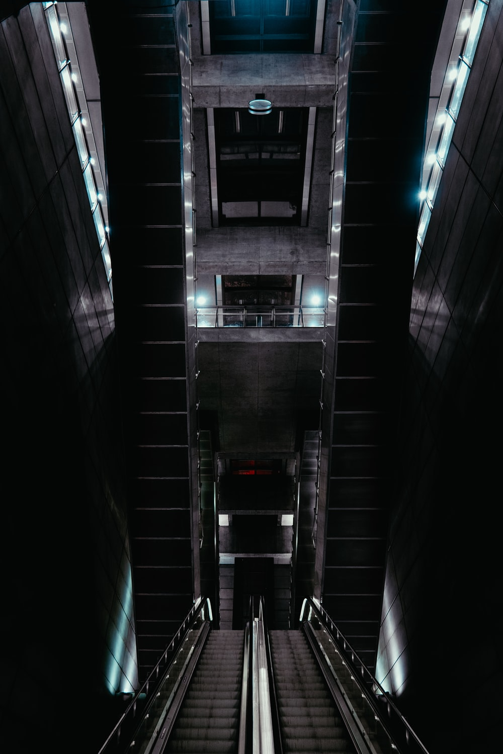 two escalators on dim lighted building