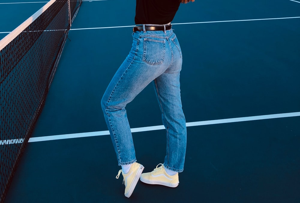 person standing on tennis court