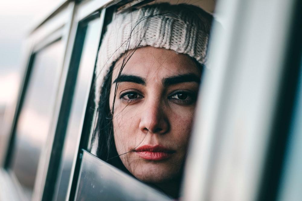 woman sitting inside car