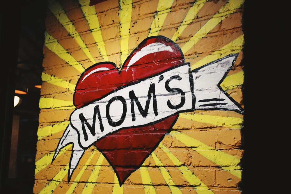 red and white heart mom's graffiti