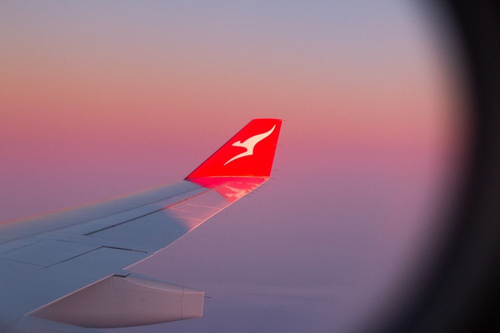 aerial photography of white and red airlines wing