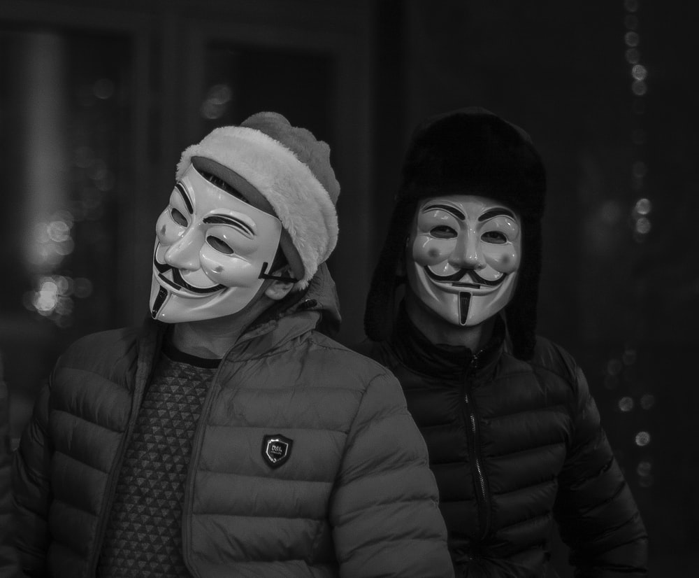 two person wearing Guy's Fawkes Masks