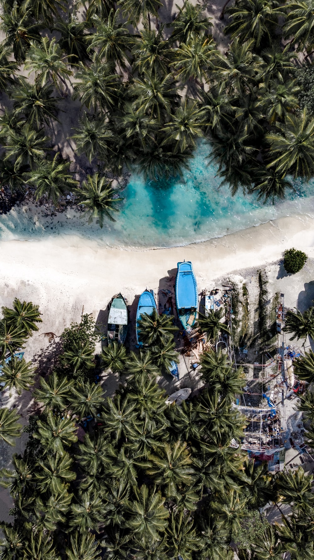 aerial photography of three boats on island