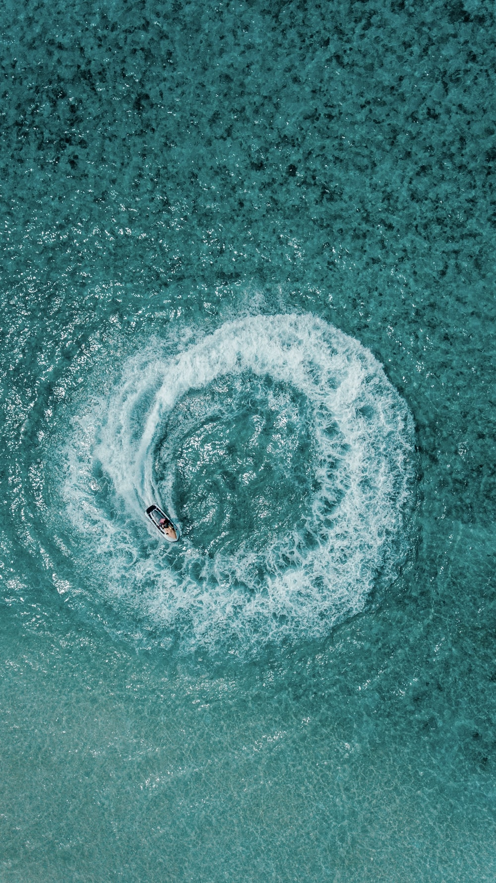 aerial shot person riding on personal watercraft