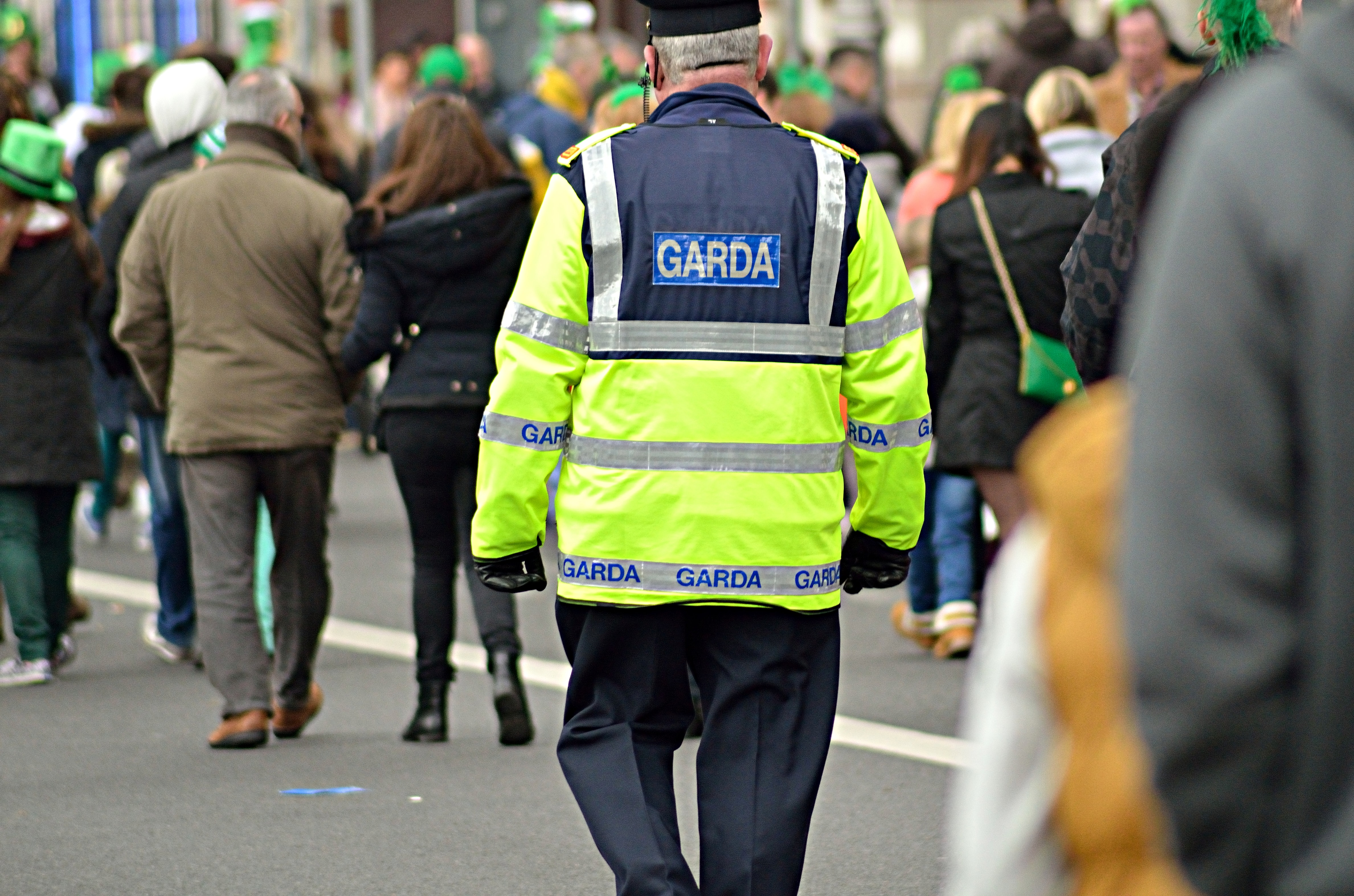 man wearing green and black police suit