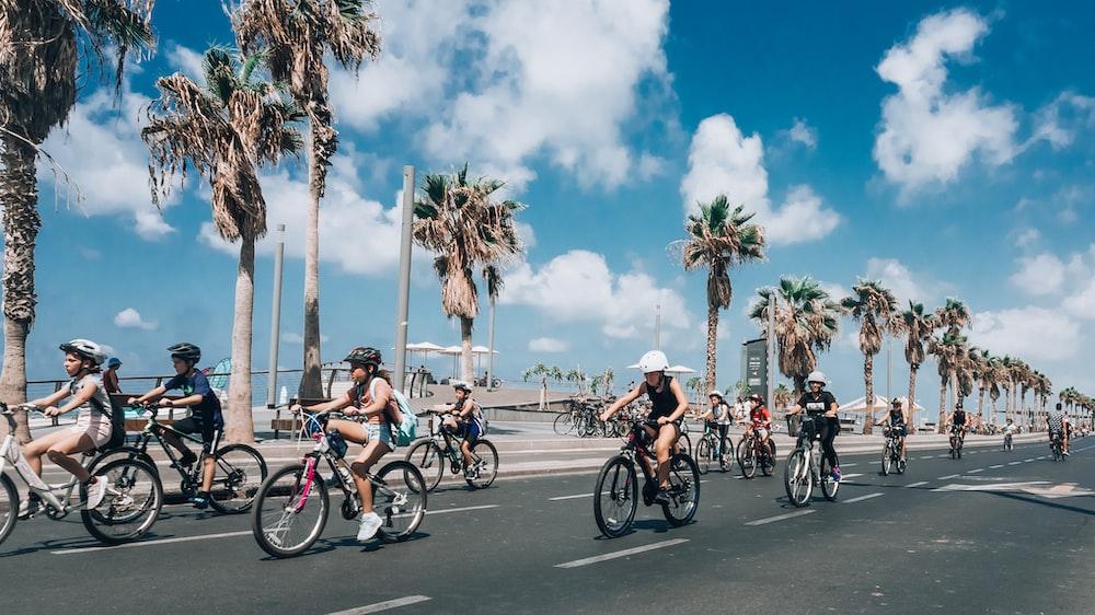 people riding on bike crossing road