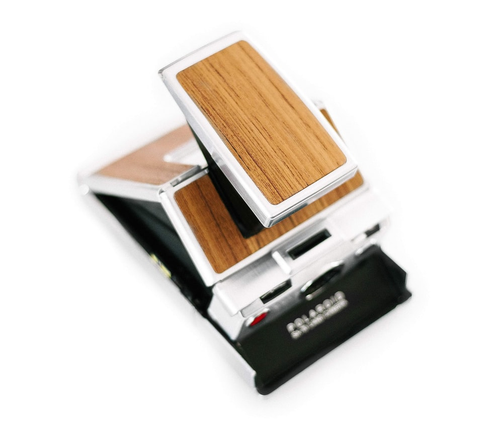 brown and gray Polaroid instant camera