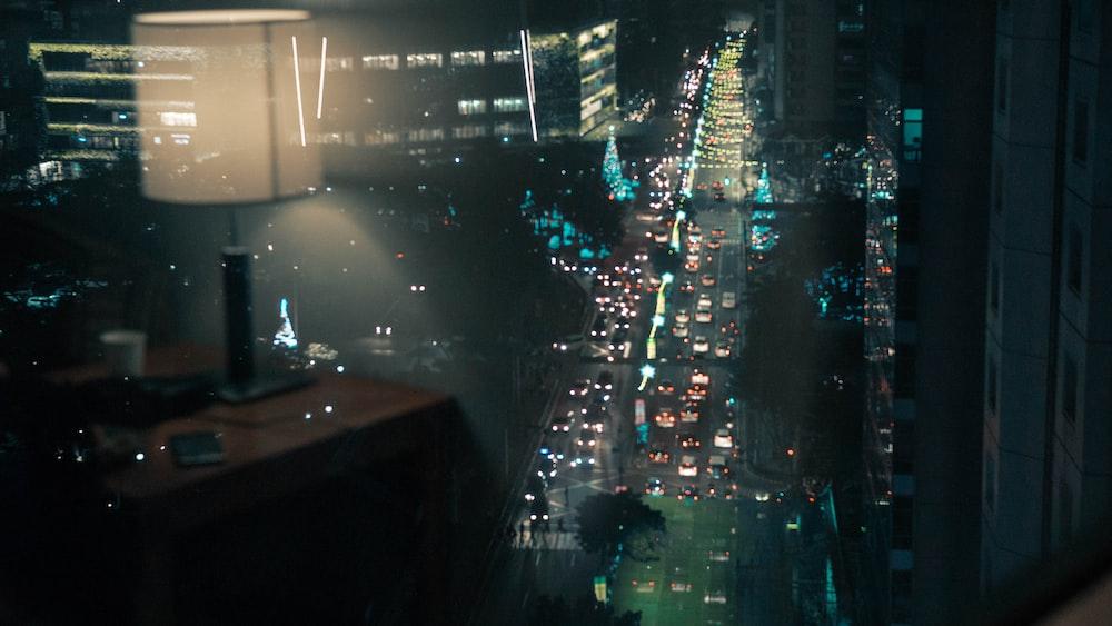 vehicle on road between buildings