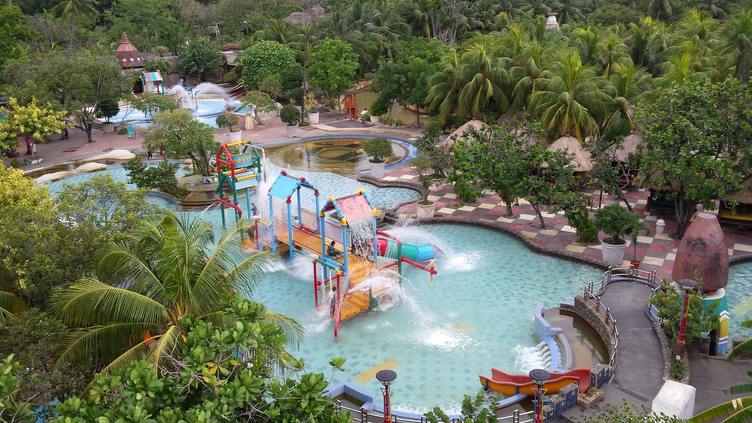 Aerial view of a swimming pool with a water slide