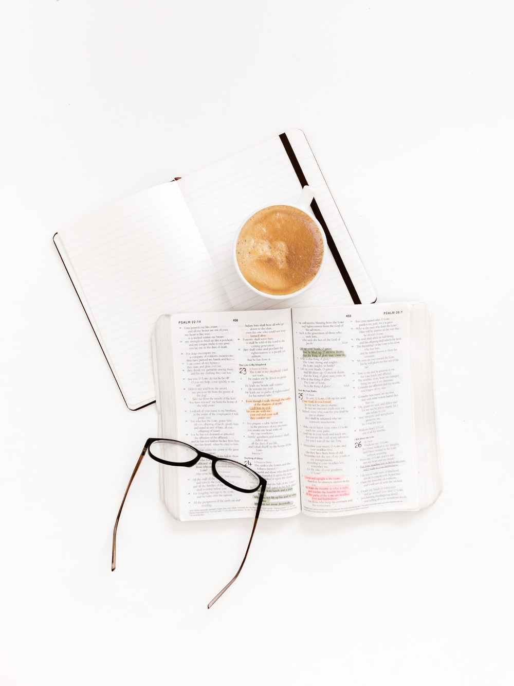 eyeglasses with black frames on top of white book