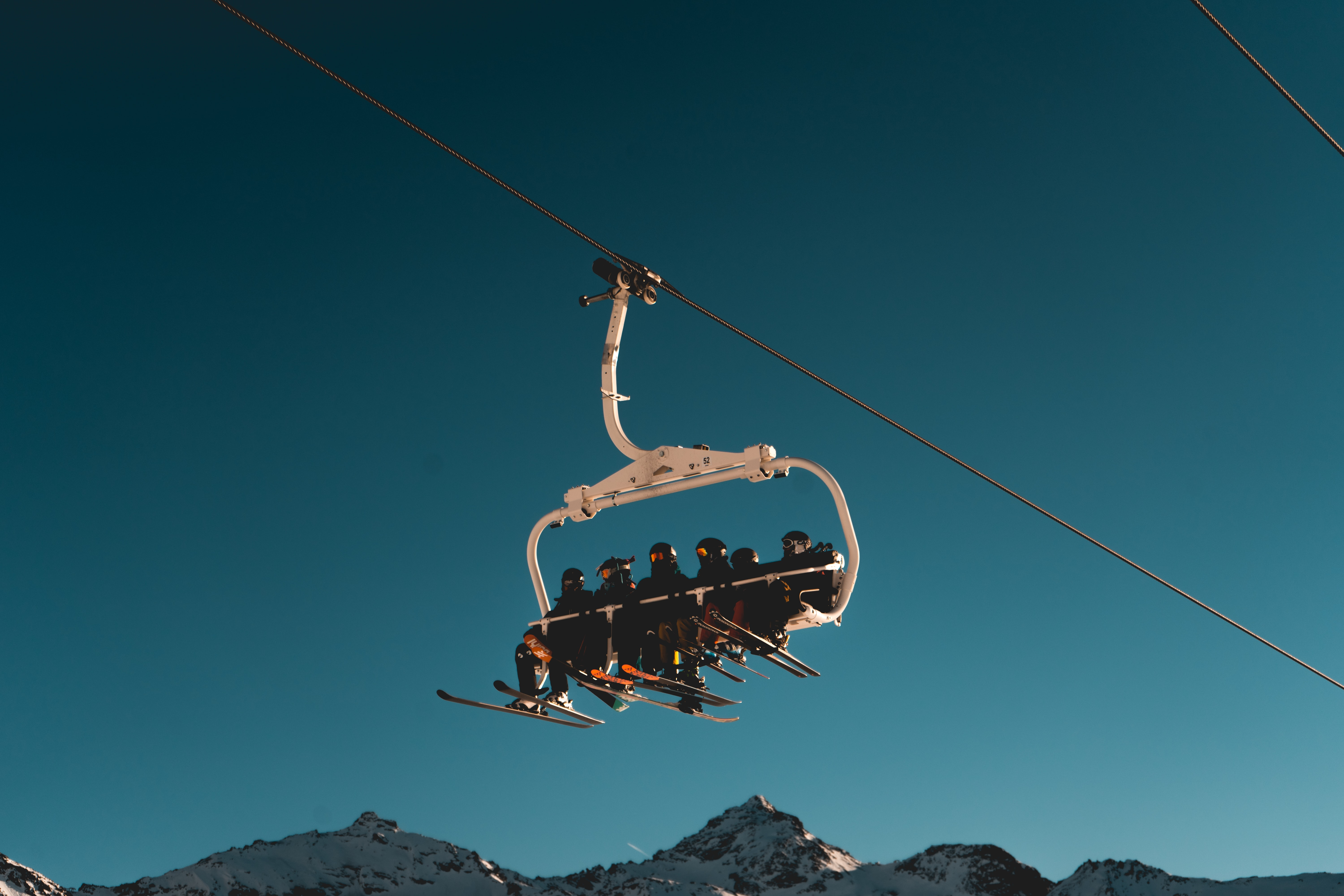 people riding a cable car
