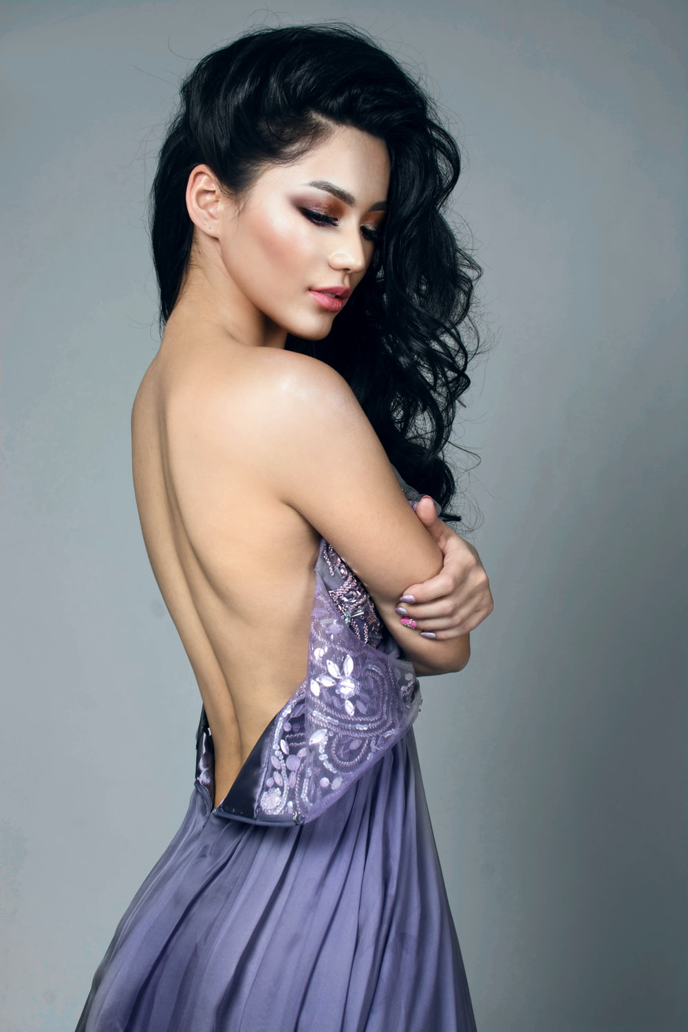 woman with back less purple dress