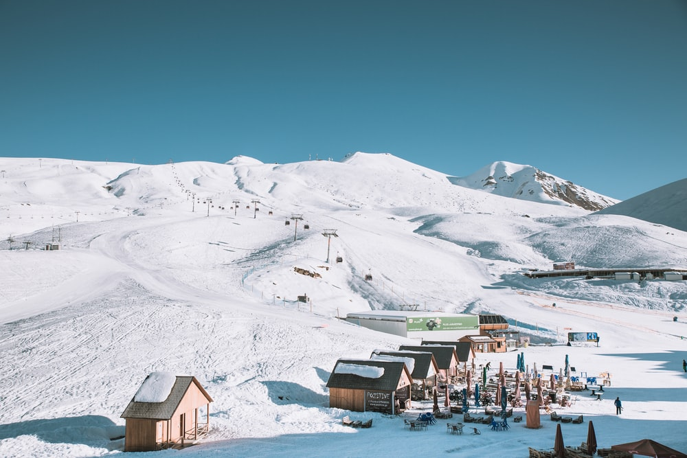 houses near snow mountain