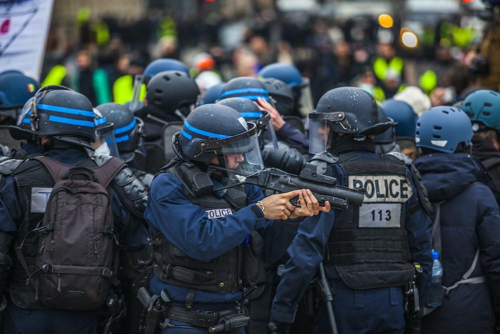 blue and black uniformed police on street