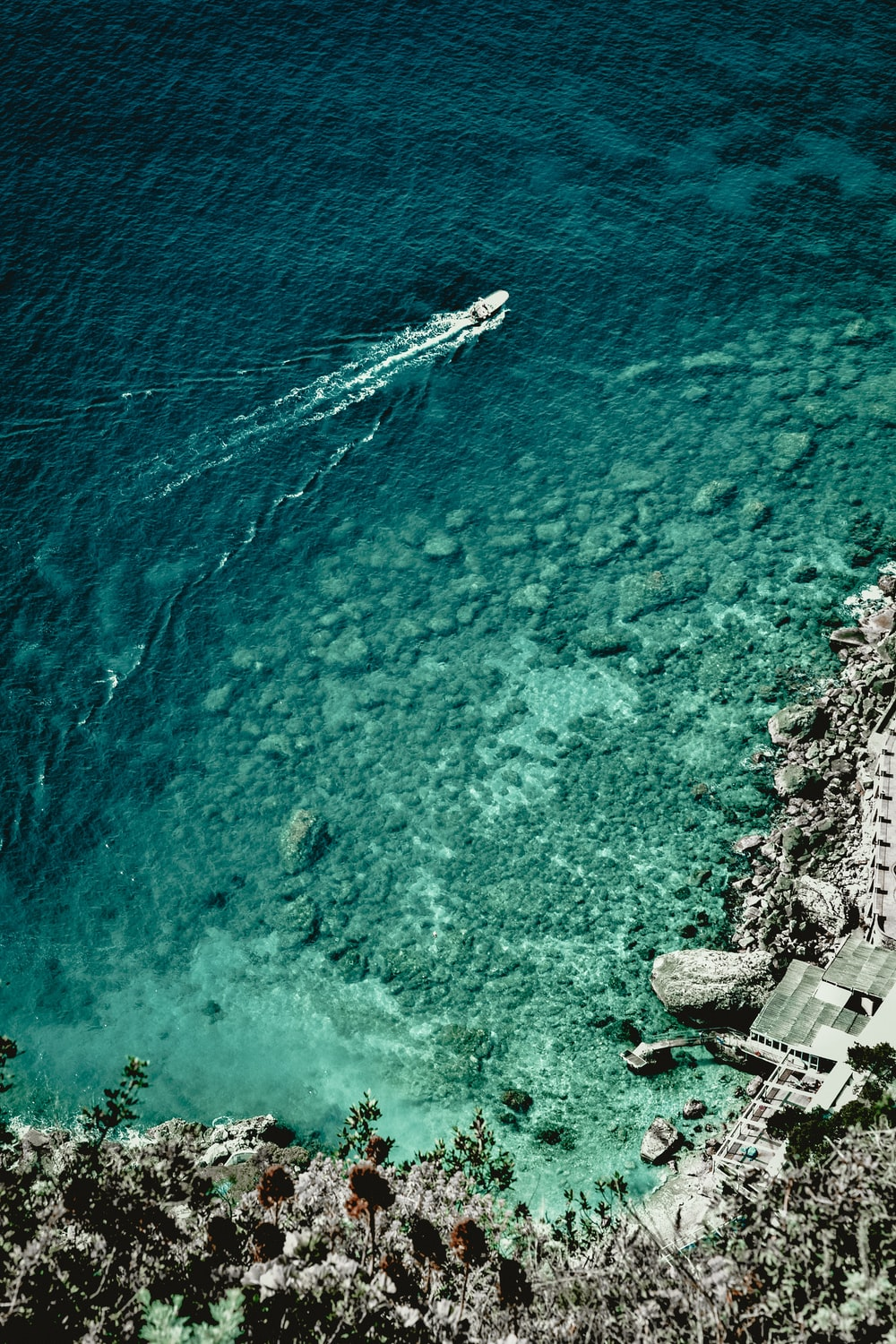 boat at sea during daytime in aerial photography