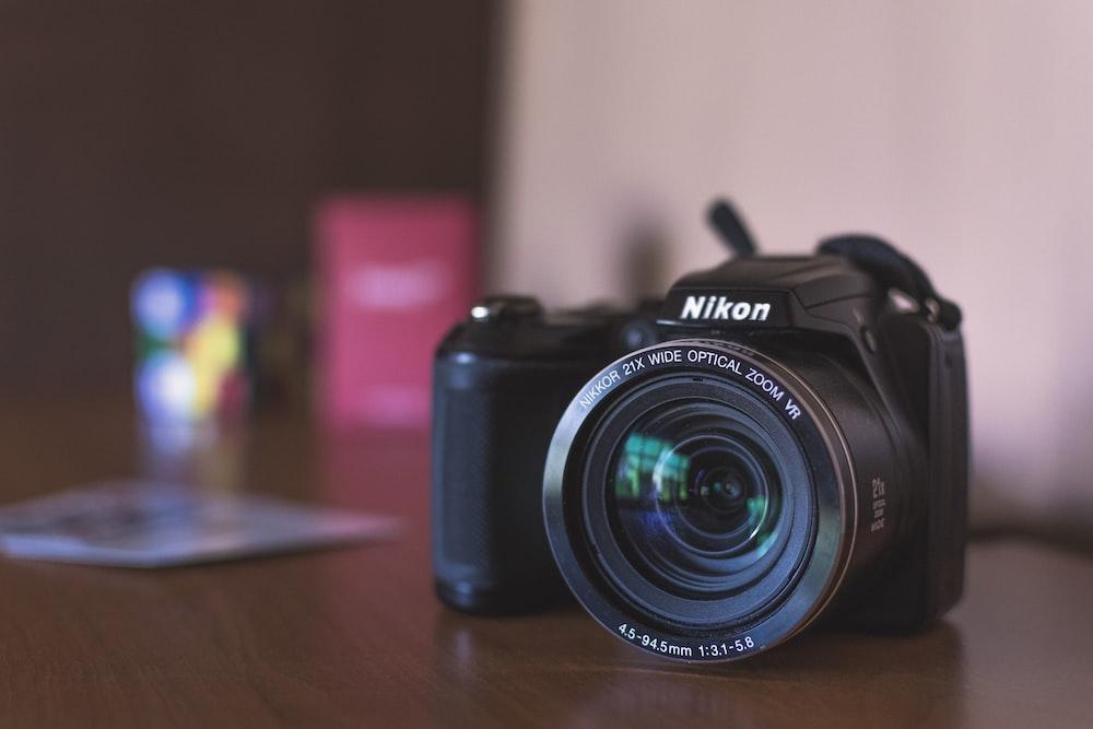 black Nikon bridge camera on table