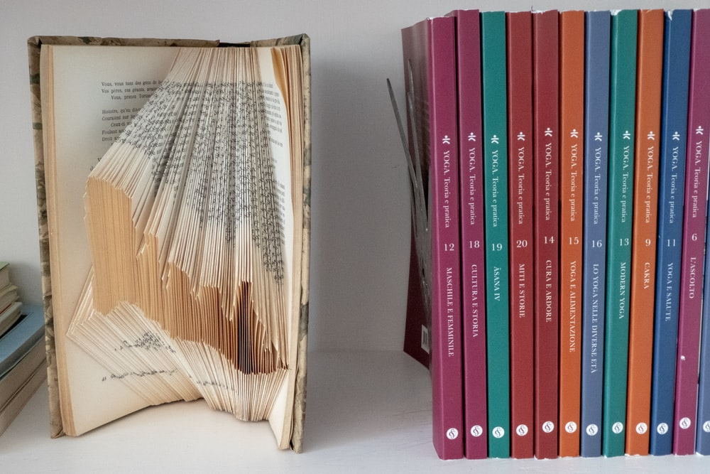 assorted-title books on white panel