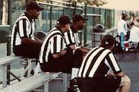 men's black and white striped polo shirt