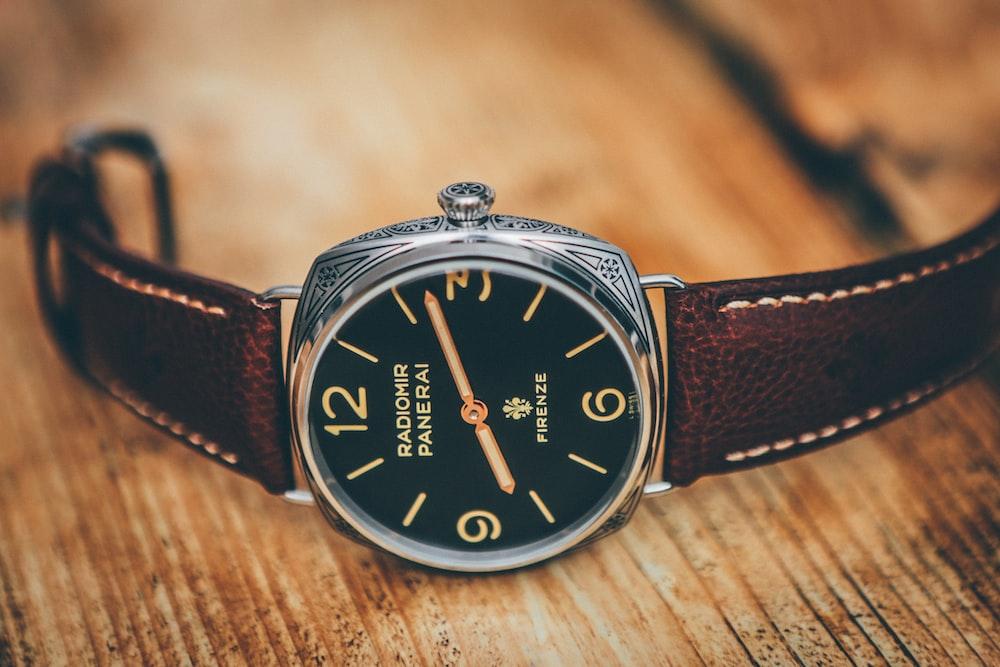 analog watch displaying 8 11