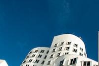 white building under blue sky during daytime
