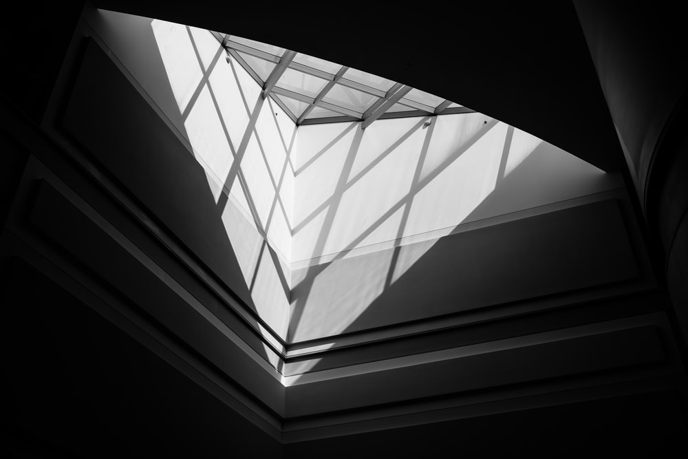 low-angle photo of glass ceiling window