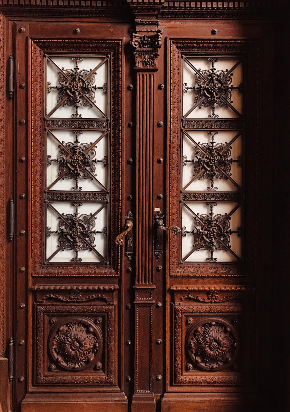 brown wooden floral carved door