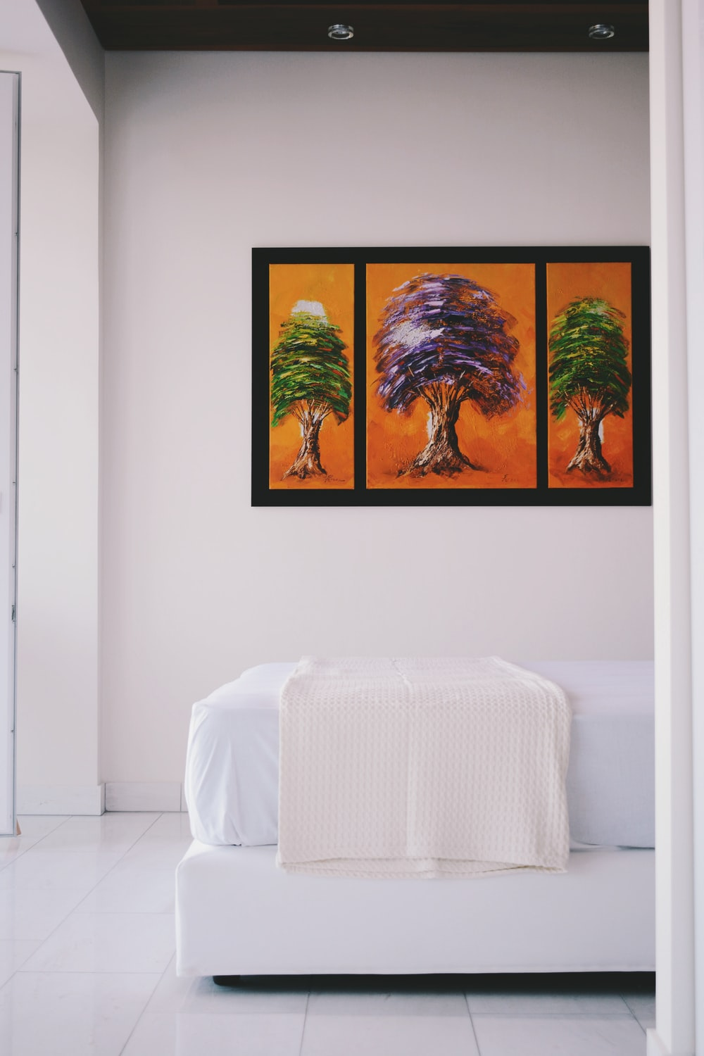 green, purple, and yellow tree painting