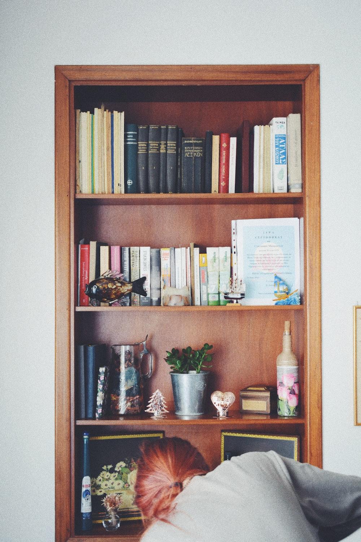 assorted books in shelf