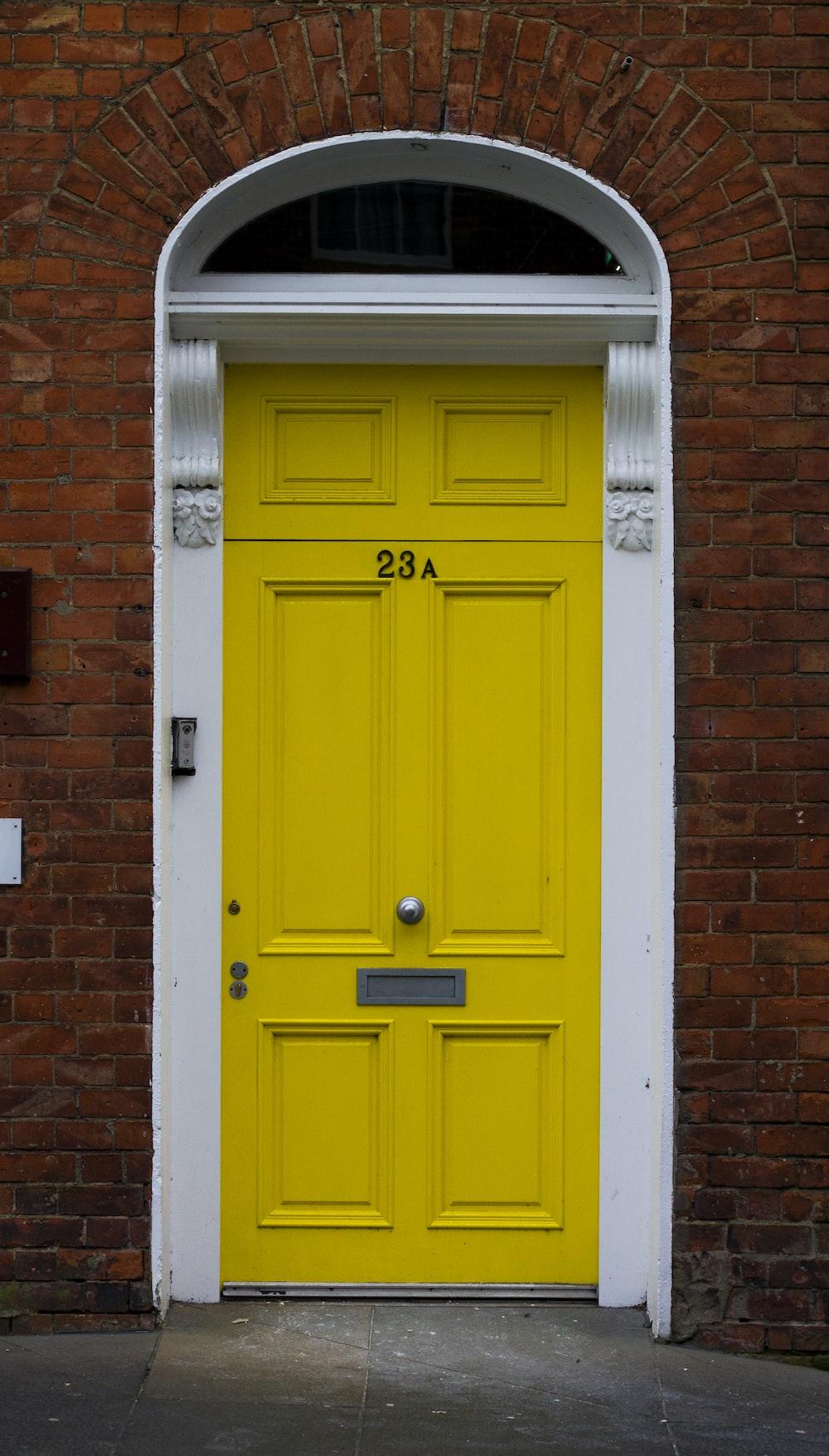 yellow wooden door is close