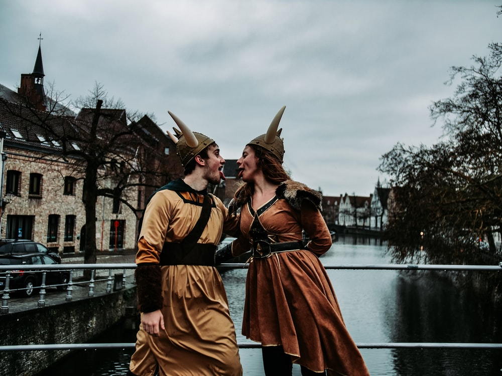 man and woman wearing brown costume
