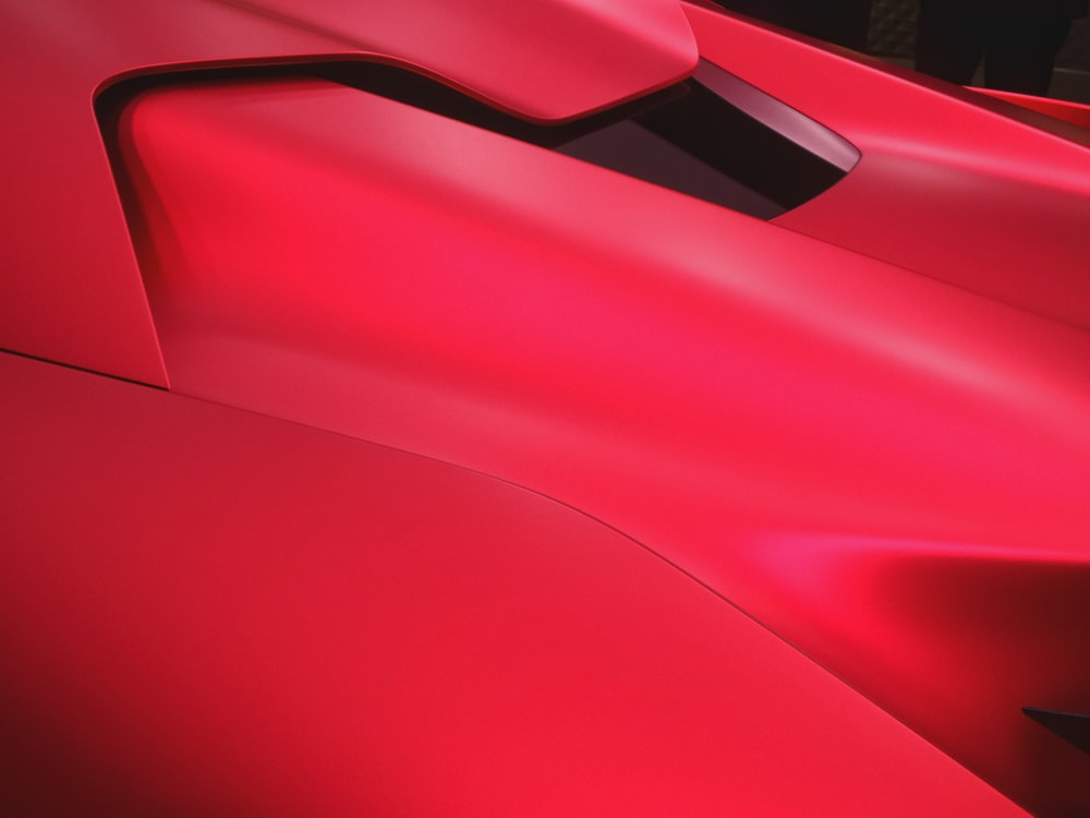 red and black car hood