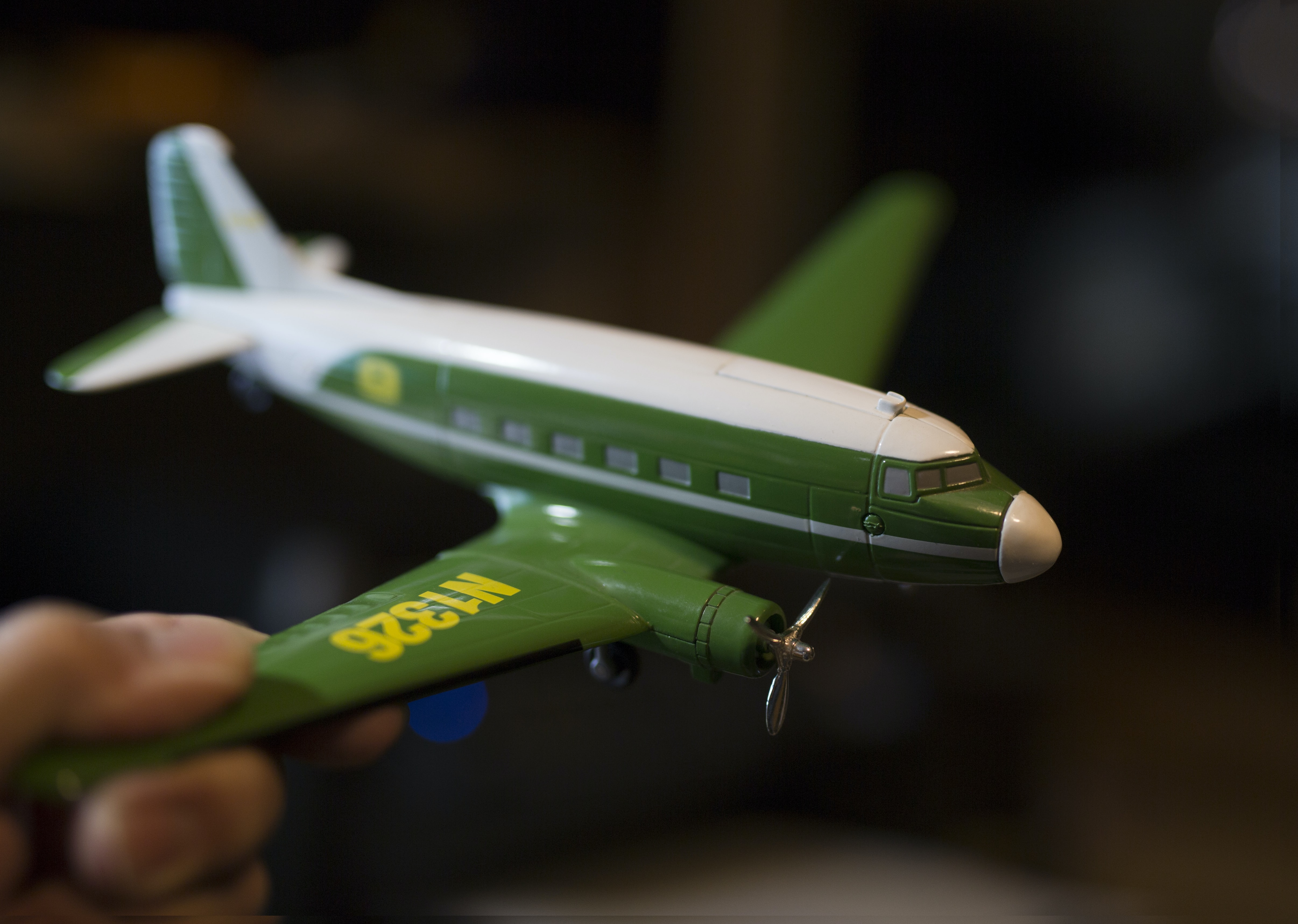 green and white helicopter toy