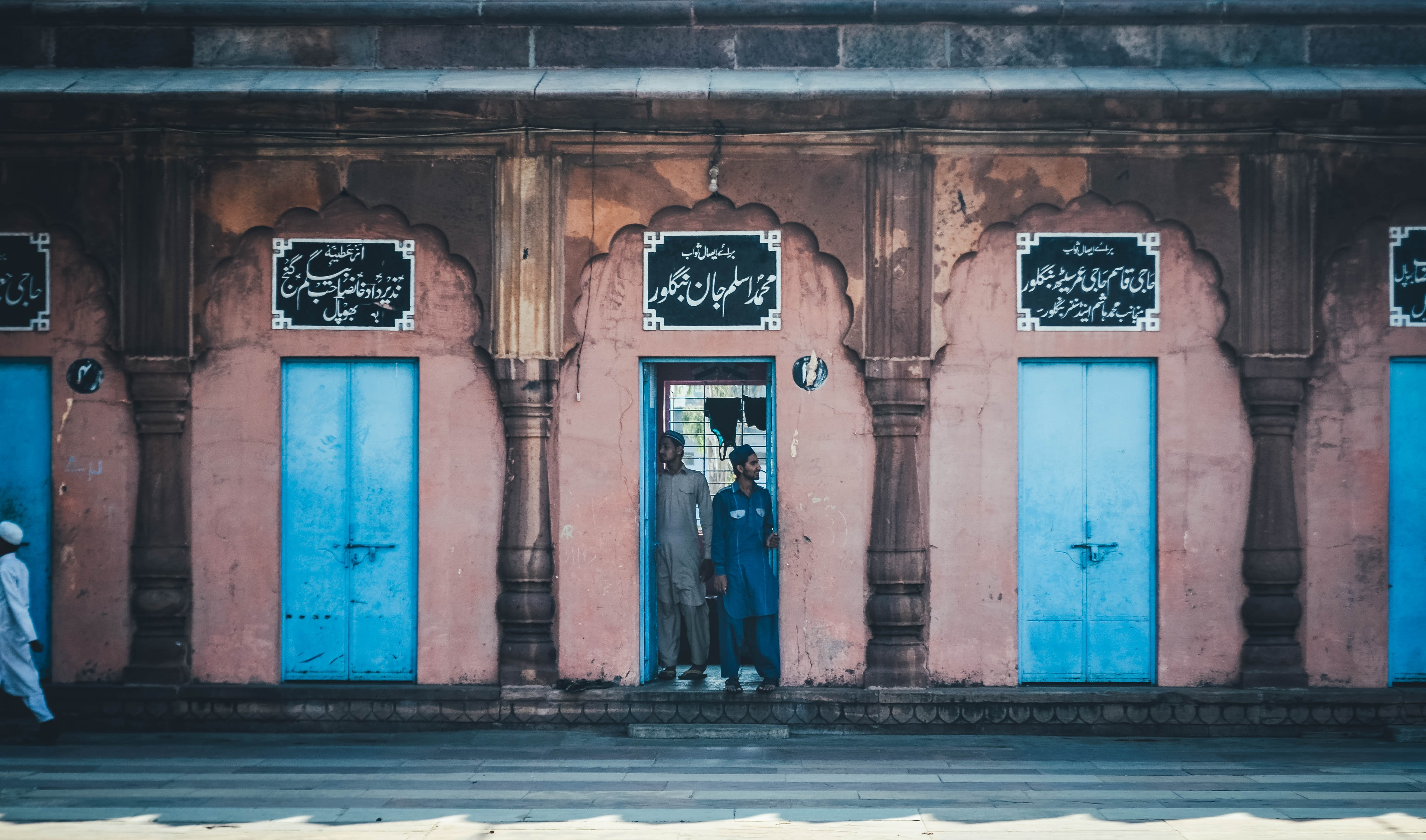 two men standing at middle of door