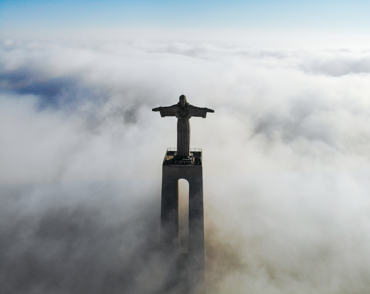 Jesus Christ Statue in Lisbon / Almada surrounded by clouds