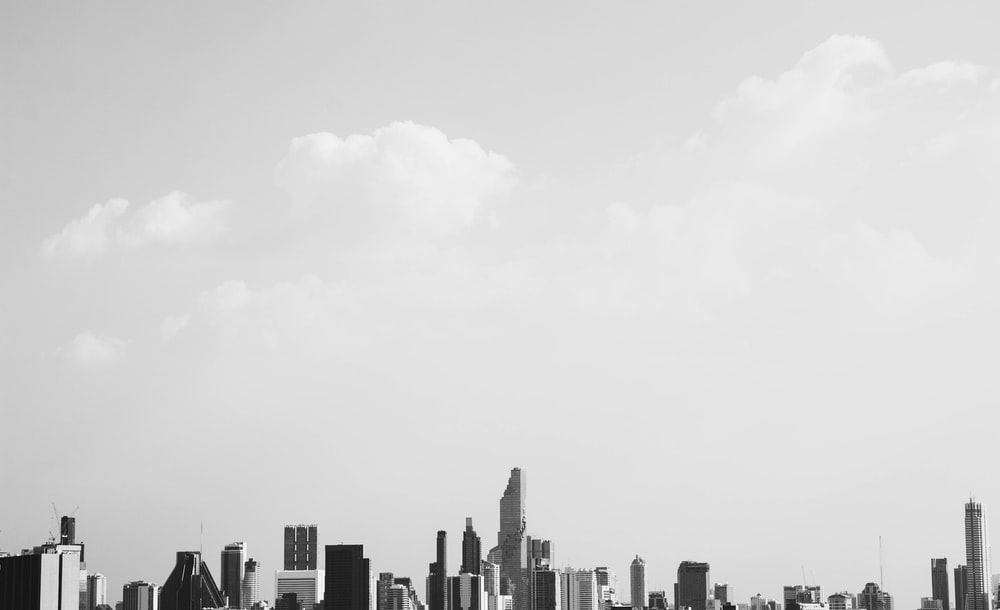 grayscale panoramic photo of buildings