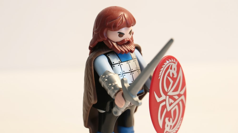 man with long beard while holding sword and shield minifig