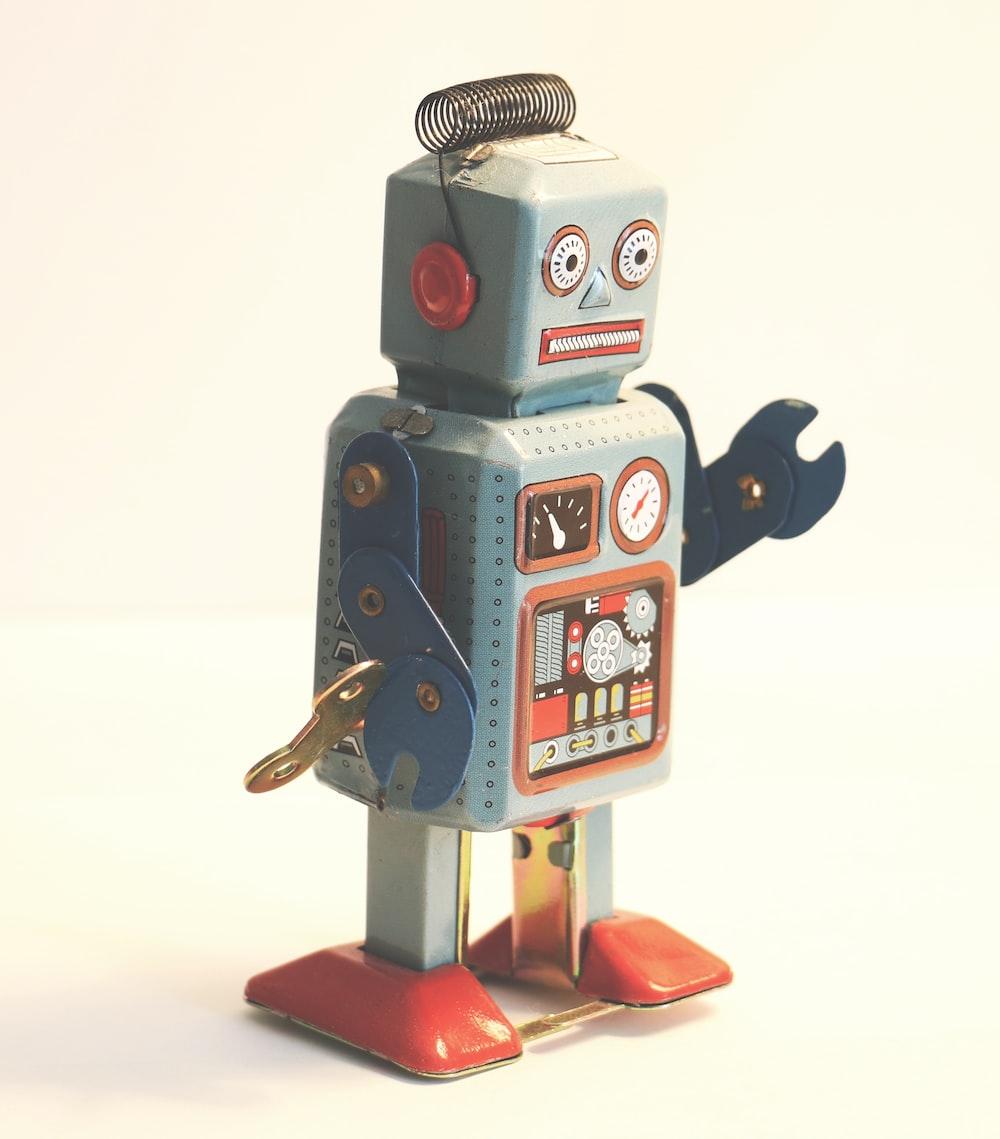 gray and orange plastic robot toy
