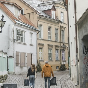 man and woman carrying black bags