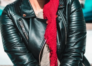 selective focus photography of woman in black leather jacket