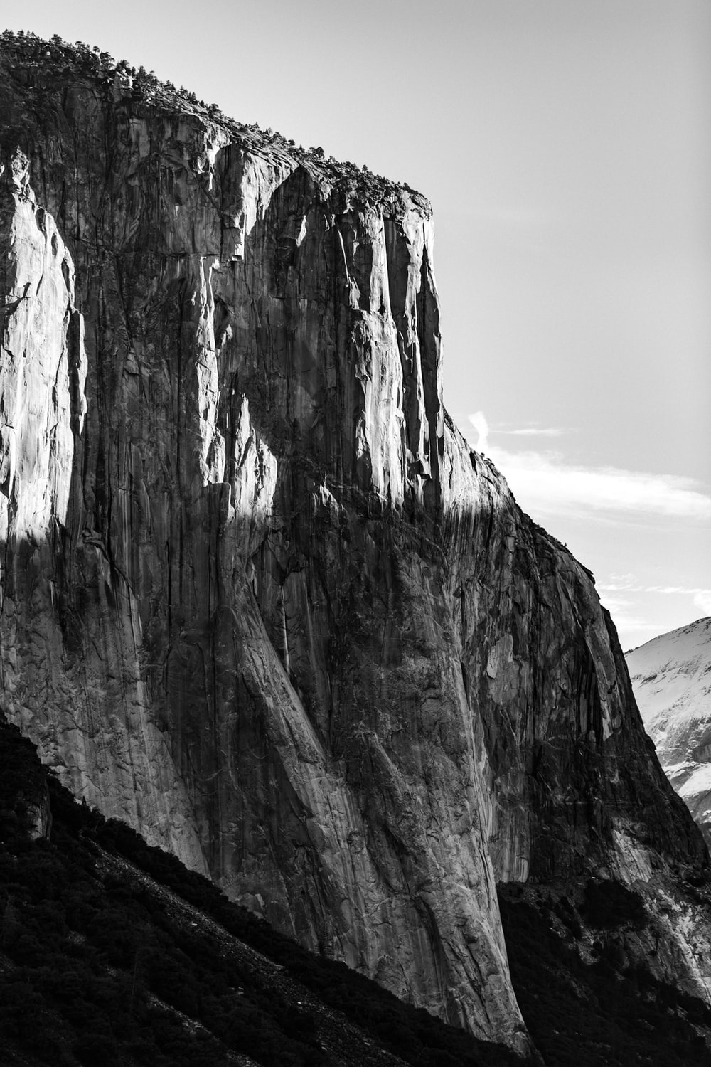 greyscale photography of rock formation