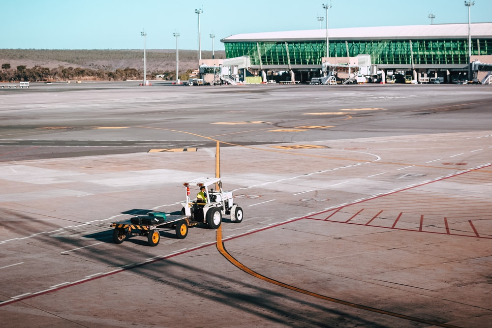 aerial photography of tow trailer in an airport