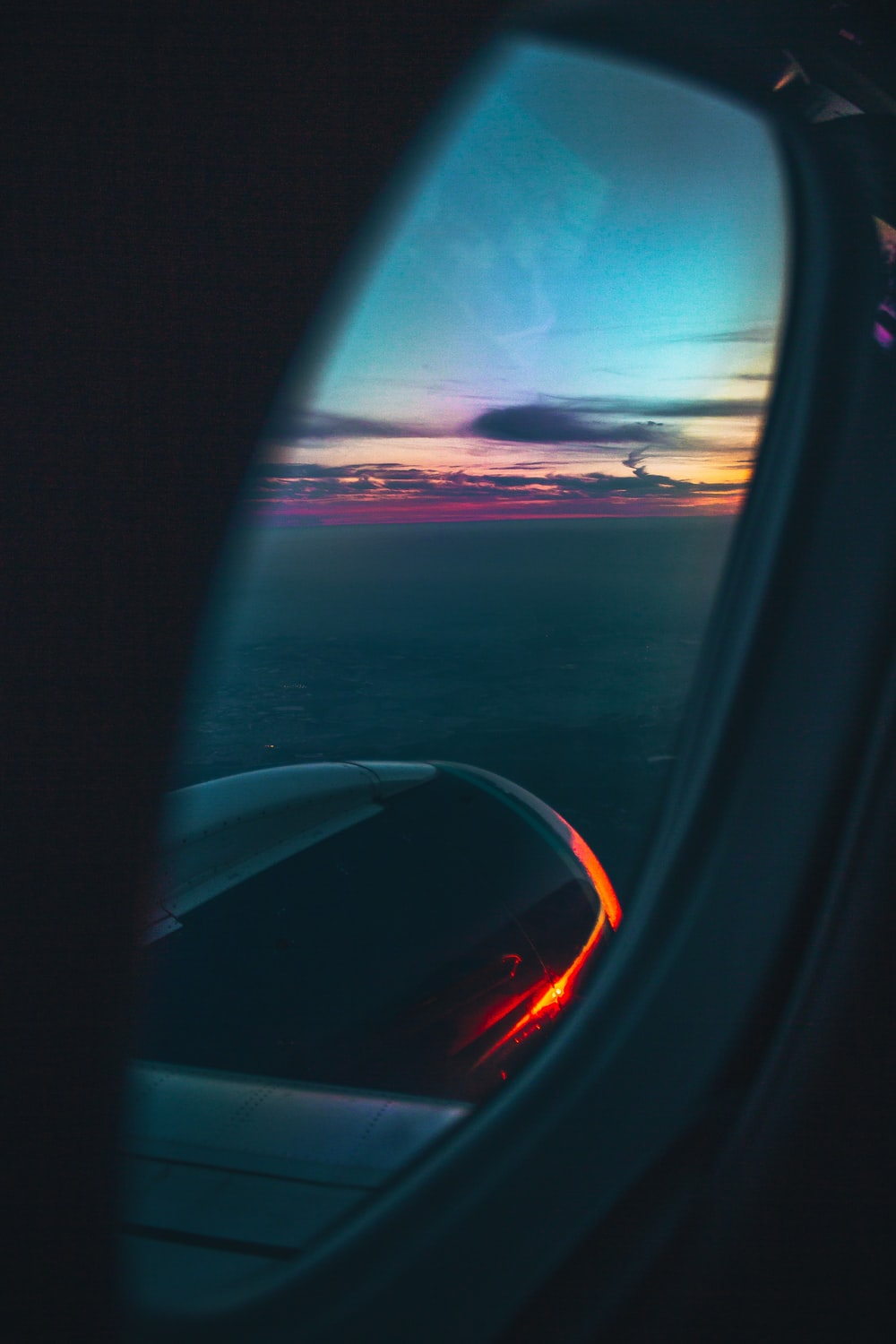 airplane window during golden hour
