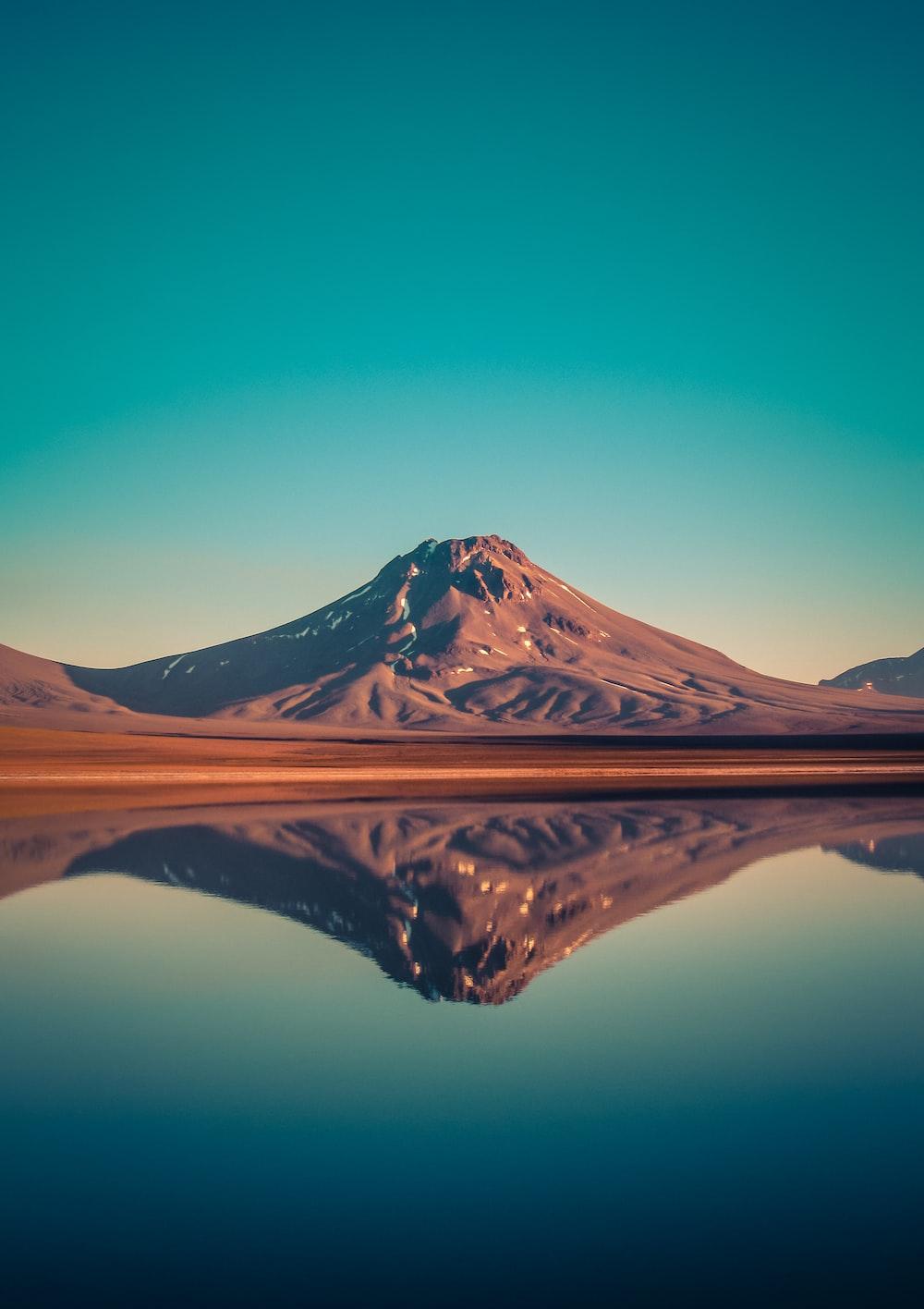 mountain near body of water view