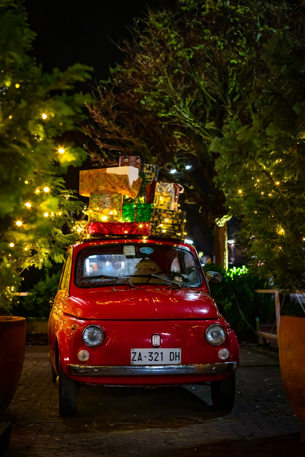classic red FIAT 500 with christmas boxes on top