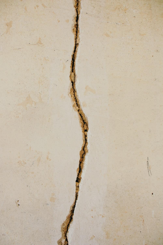 crack on white concrete surface