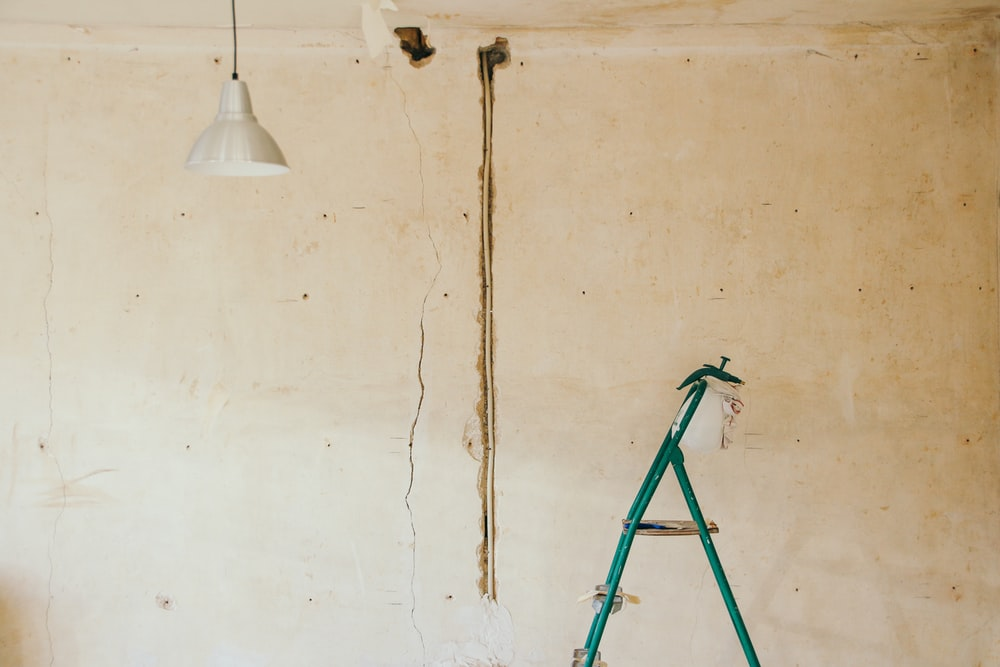gray pendant lamp beside wall