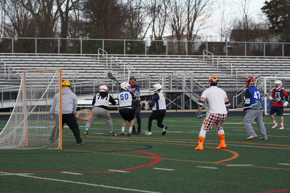 lacrosse players on field