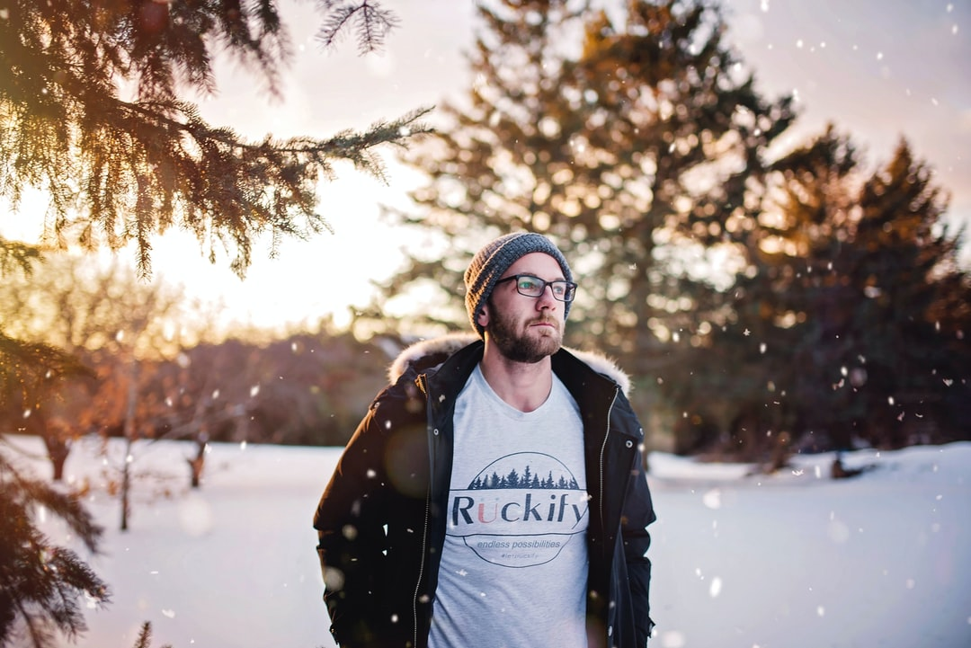 My brother in the snowy forest. I love the mood and light in this one! Evening photos are always the best.   ** Please note that I am the brand owner of the business on his shirt. The business is about saving the planet and we have a mission to plant 10 million trees.  Check us out: www.ruckify.com